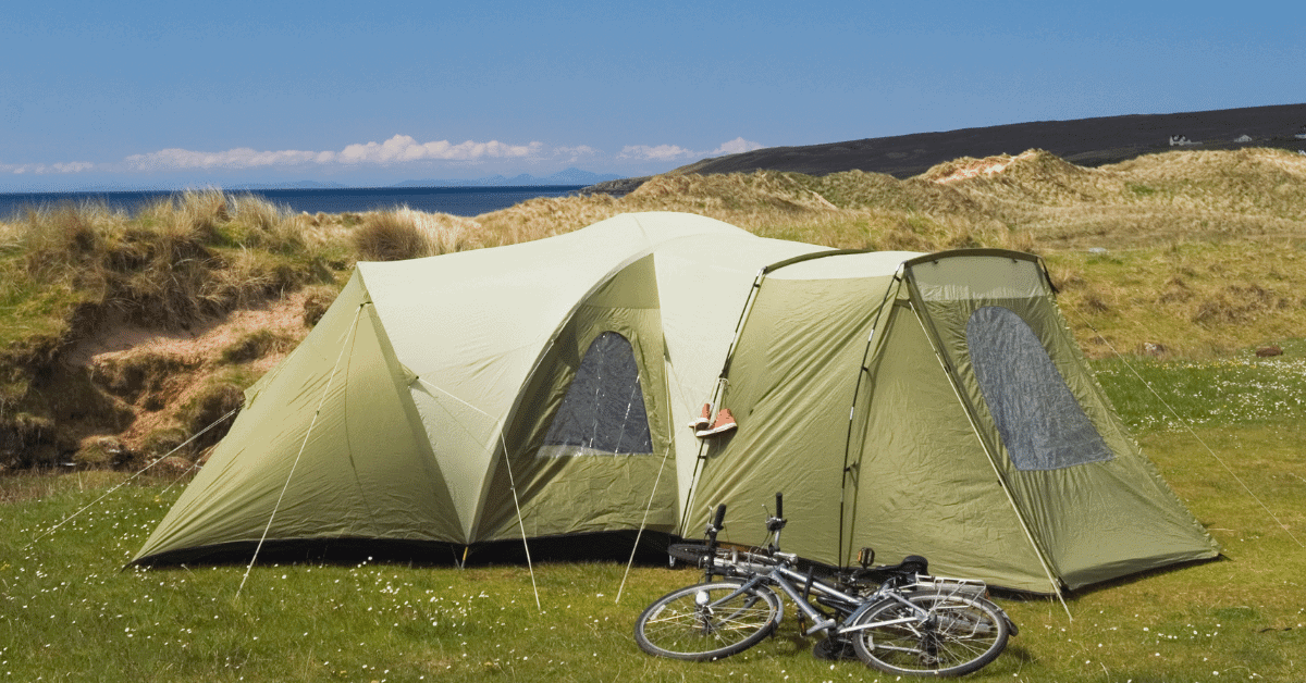 a family camping tent with a bike in front