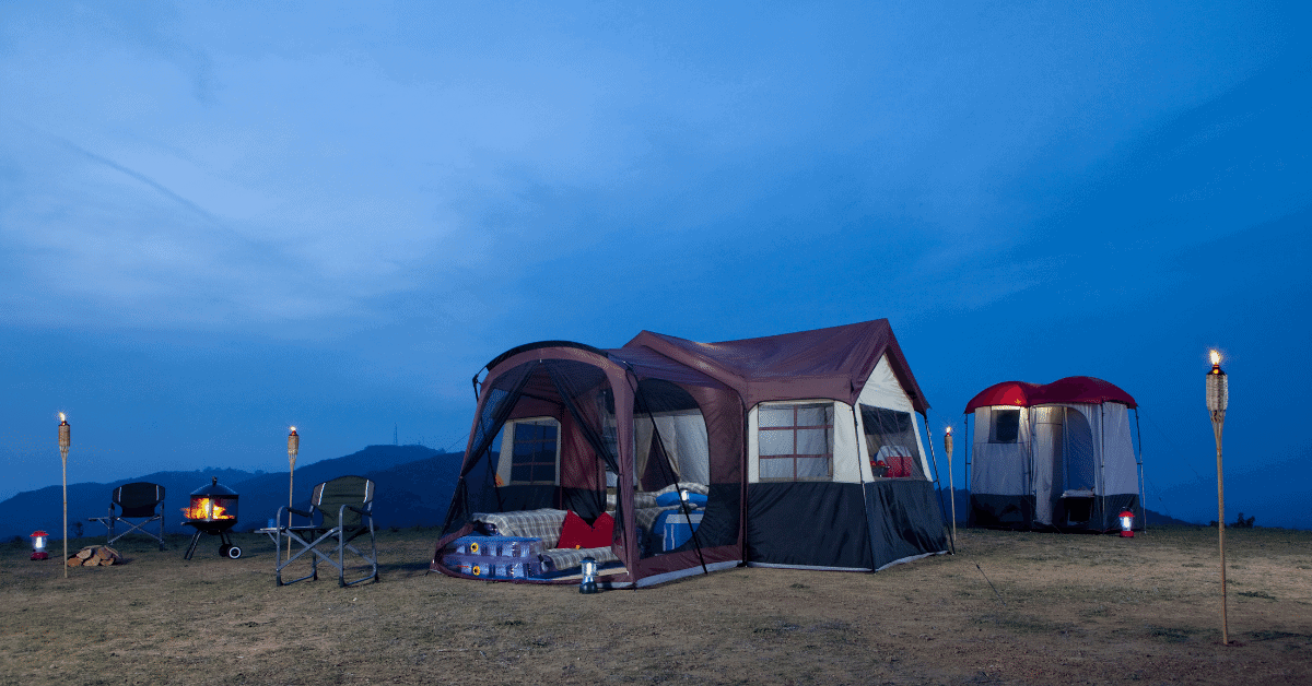 a large 3 room tent at night