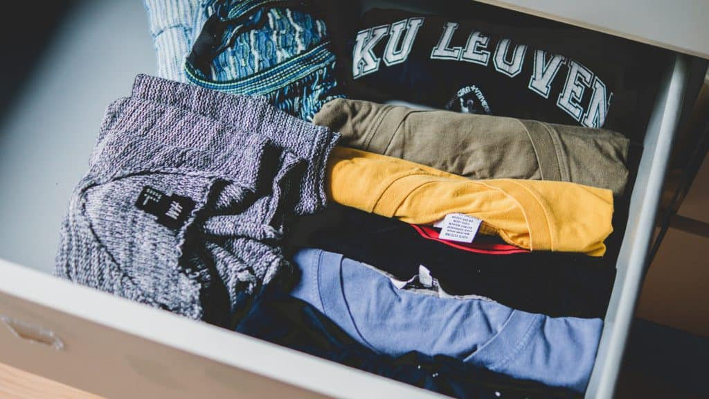 T shirts and clothes in a drawer