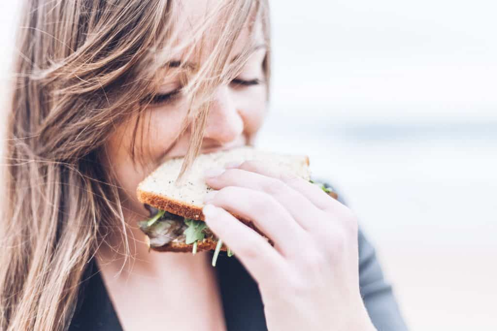 Girl eating a sandwich