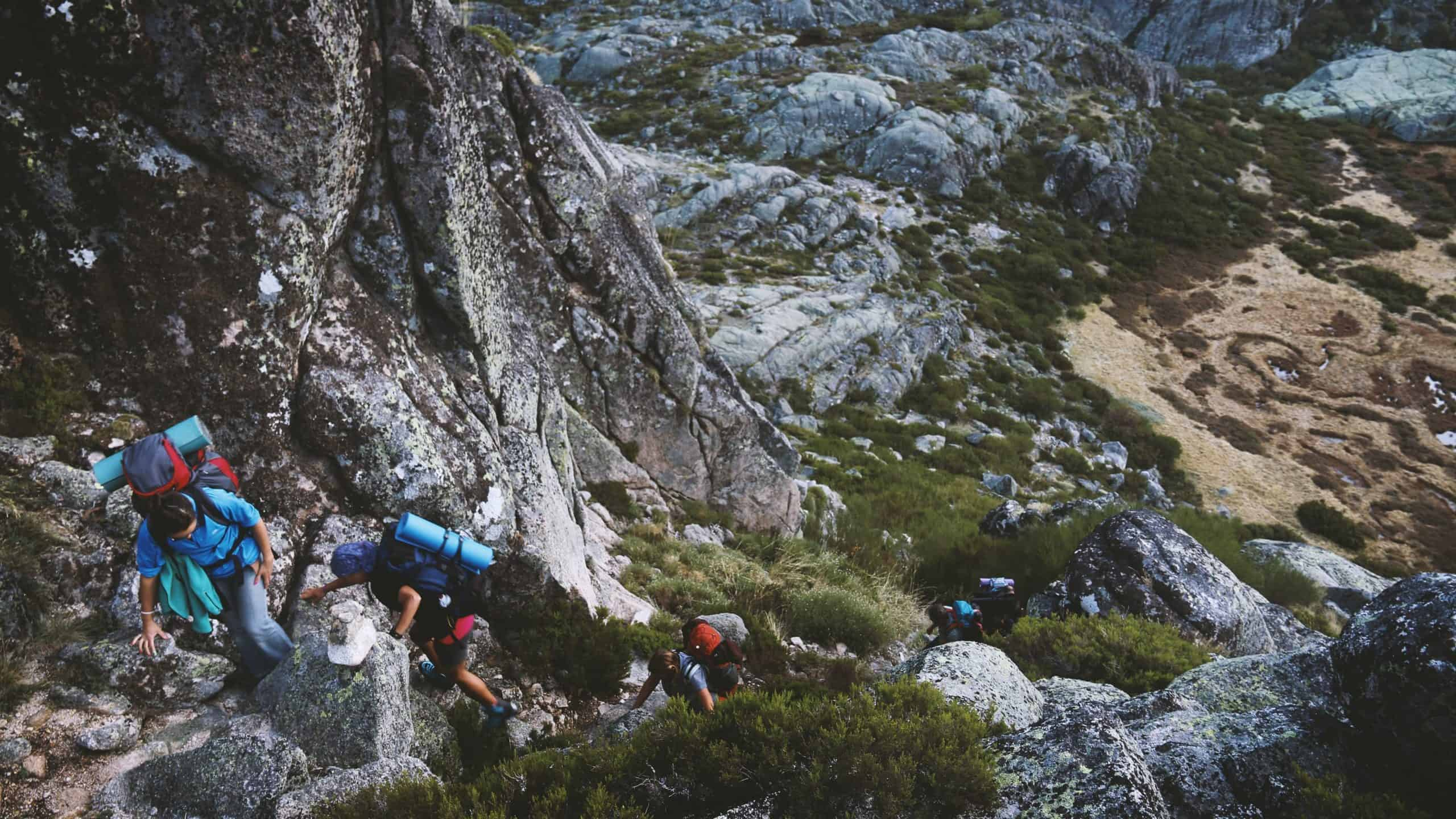 people climbing a mountain