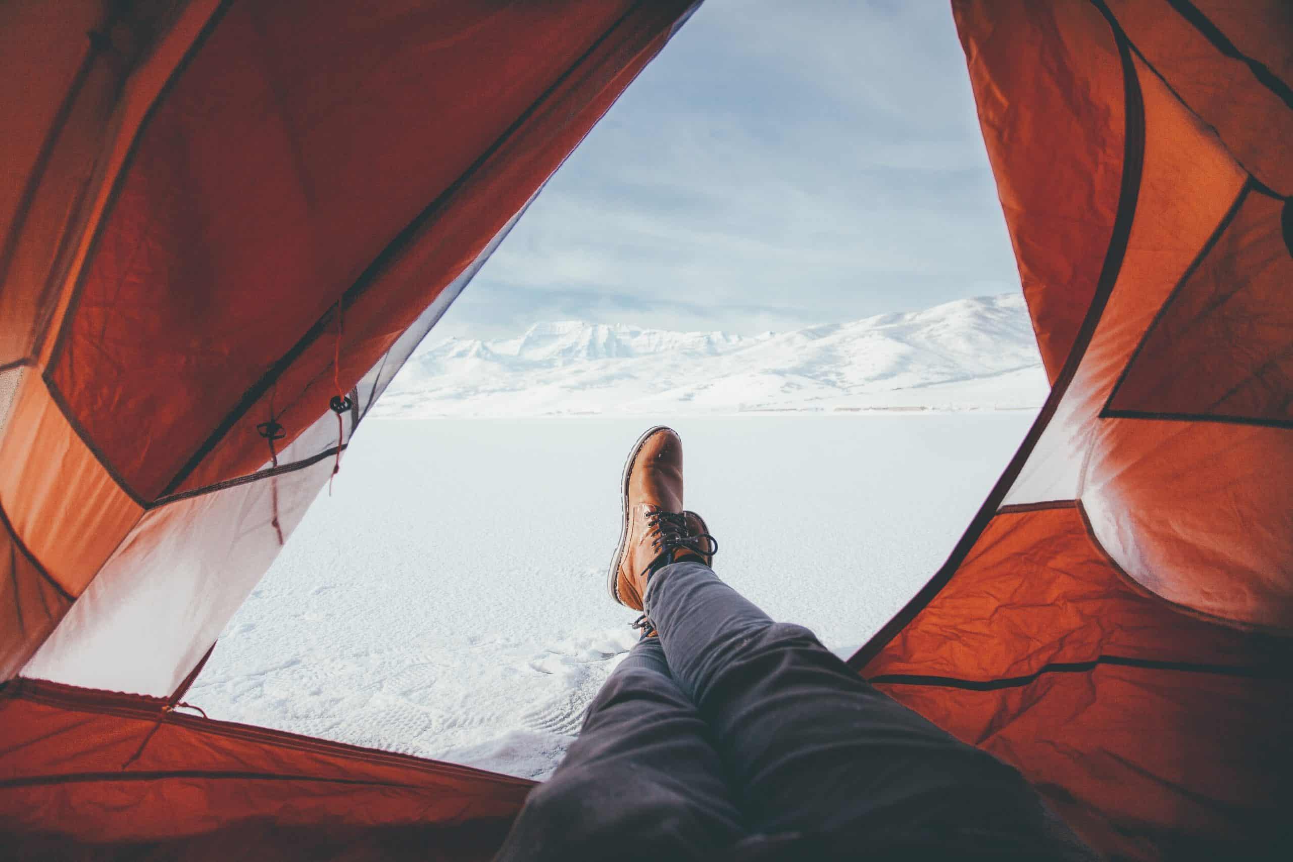 a man enjoying winter camping