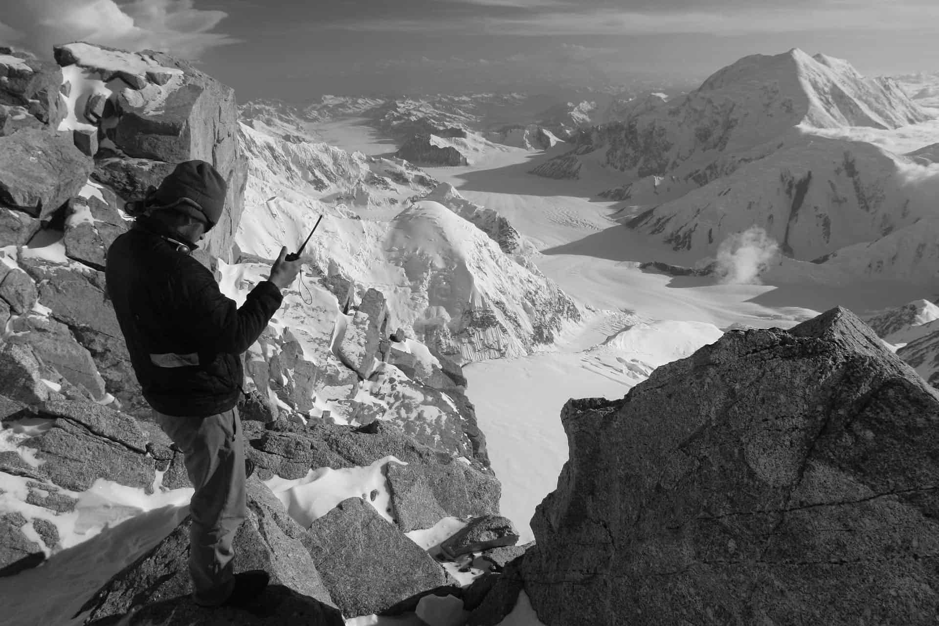 mountaineer with a two way radio