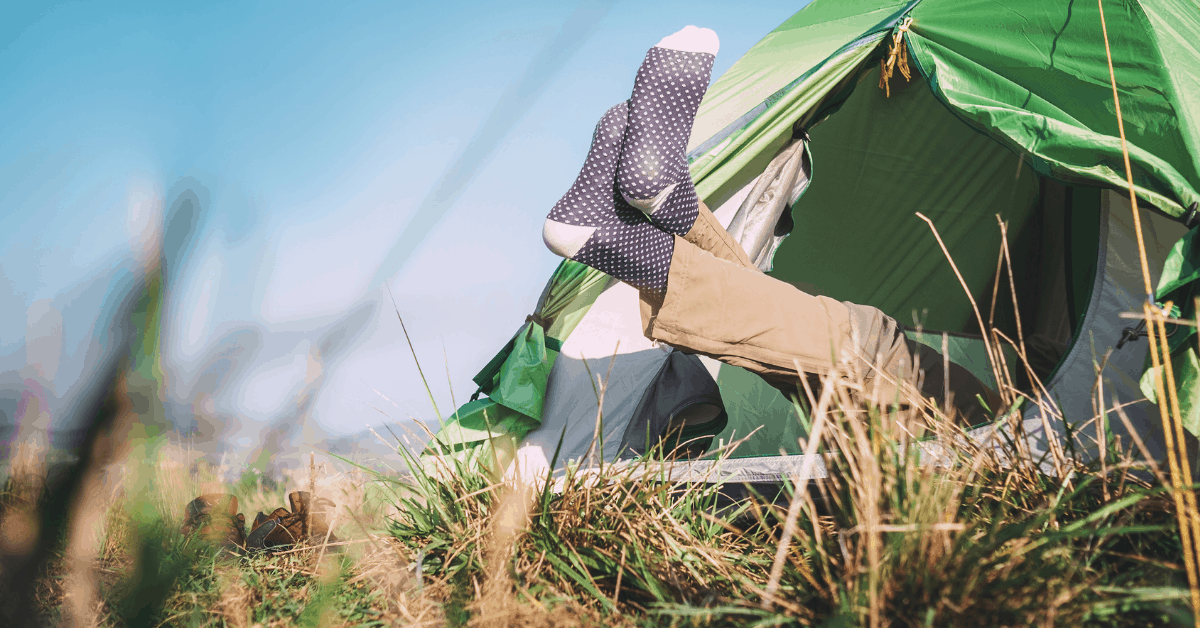 tall person camping in a tent