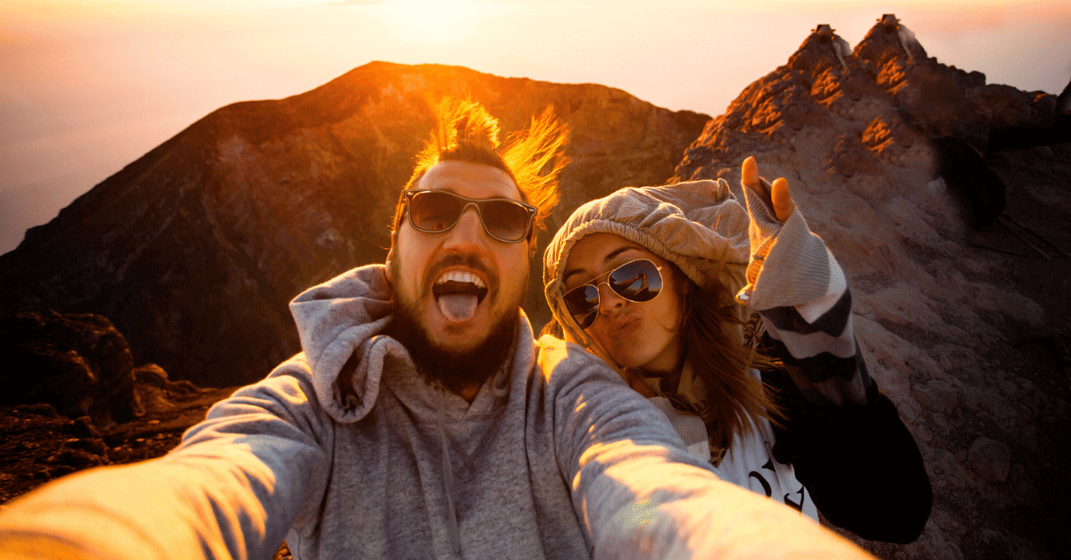 couple taking selfie on top of a mountain