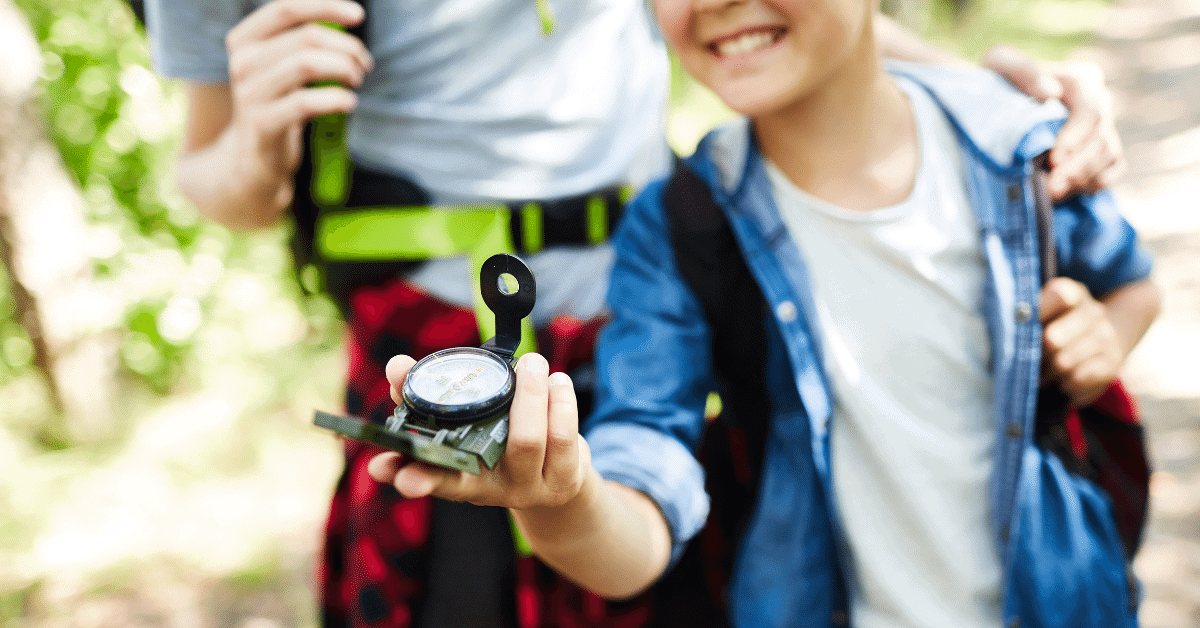 girl holding a compass