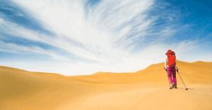hiker walking through the desert