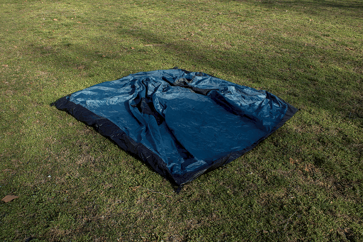 tent laid out flat on the ground