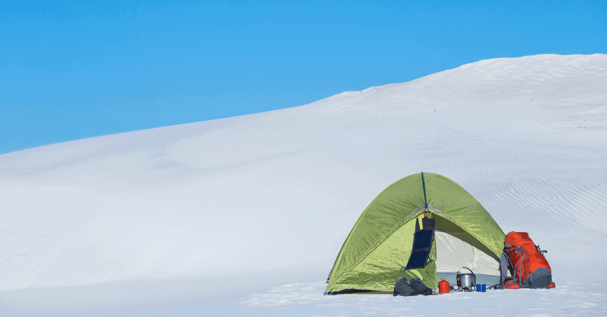 tent on a mountain in the snow