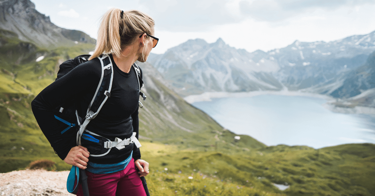 girl in the mountains overlooking a lake