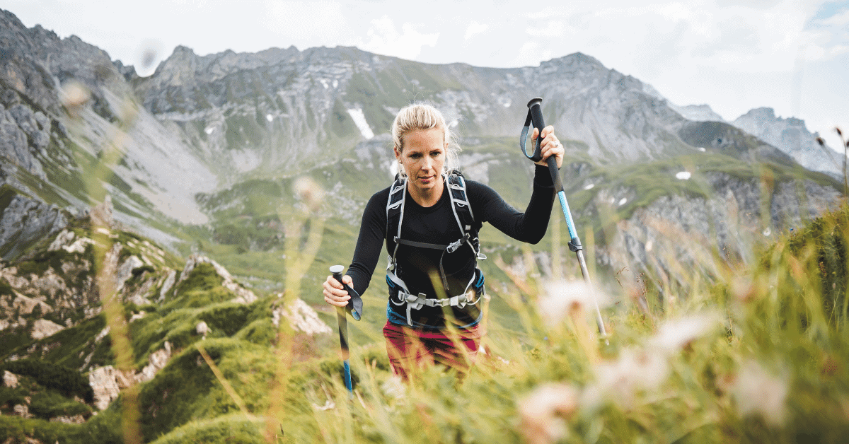 woman hiking with trekking poles