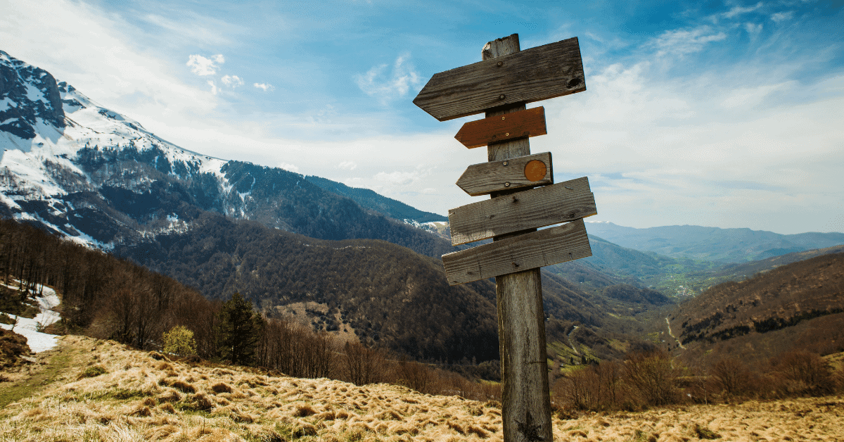 a sign post on a hiking trail