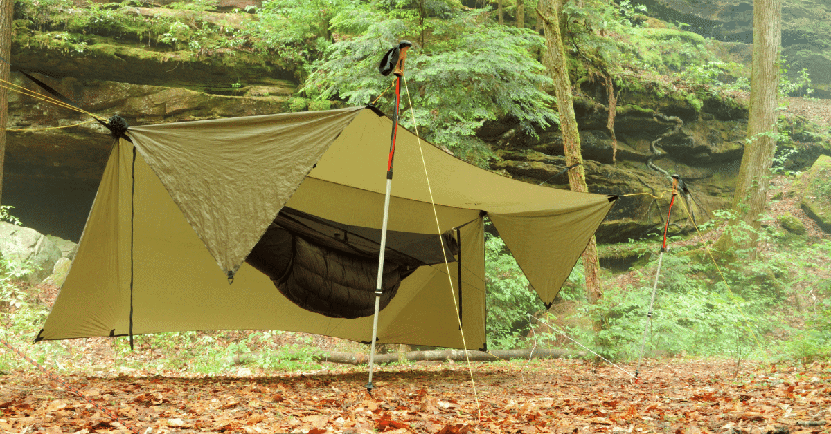 a hammock with a tarp and an underquilt