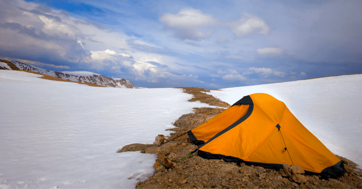 a tent in a snowy environment