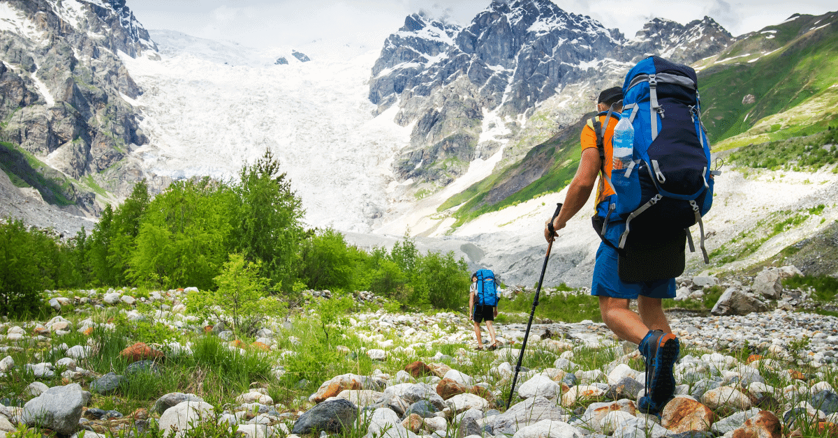 2 hikers walking through the mountains