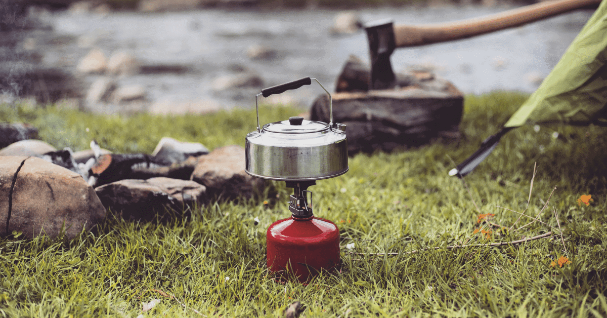 a cooking pot on a camping stove