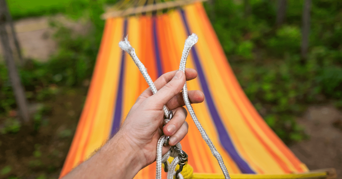 a person holding a snapped hammock rope