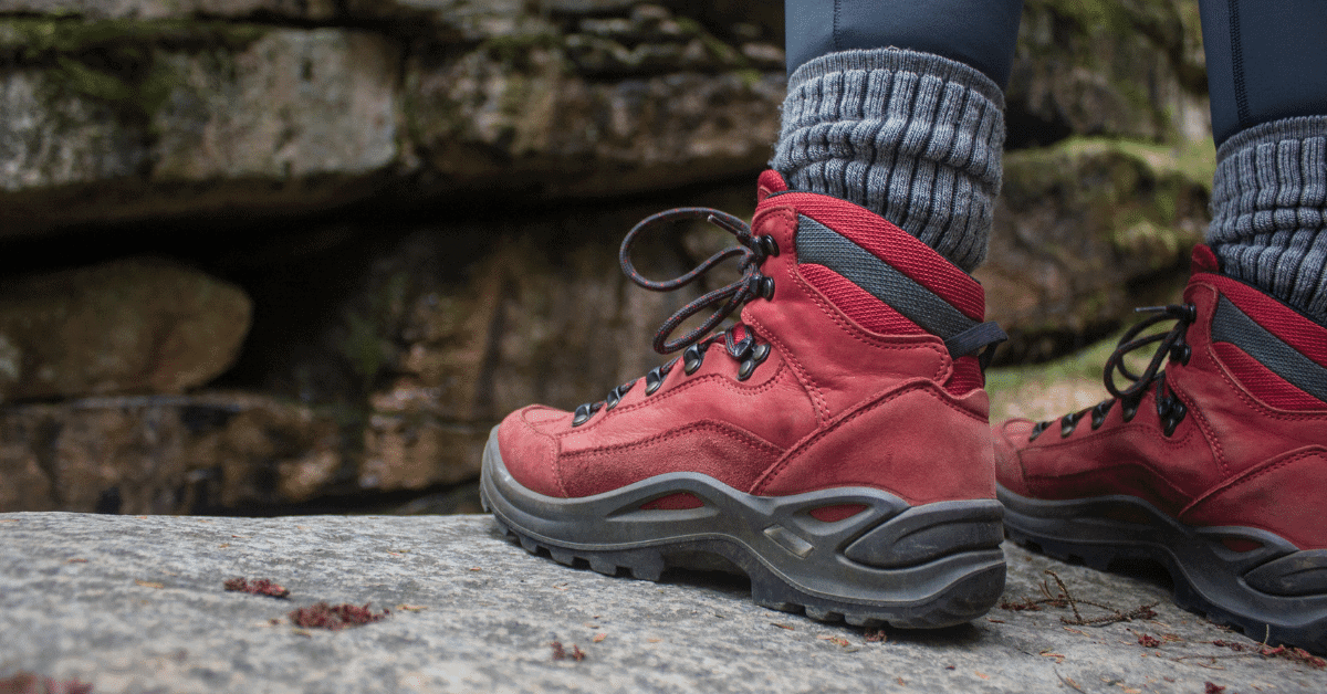a person wearing red hiking shoes with thick socks
