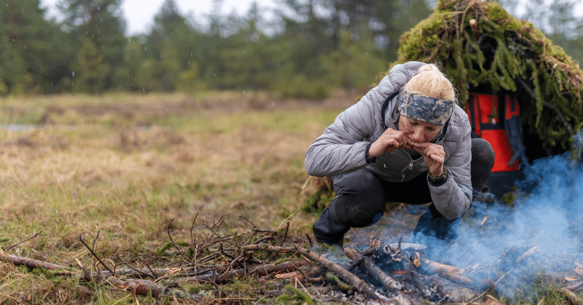 a woman on a survivalist camping trip