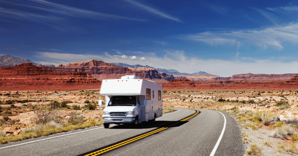 an rv driving through what looks like arizona