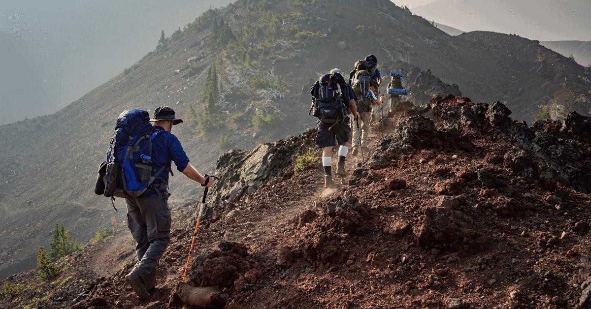 hikers walking along a rocky trail