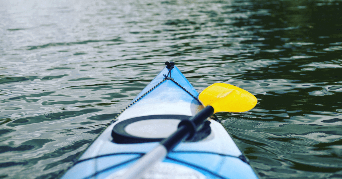 the front of a kayak in the water