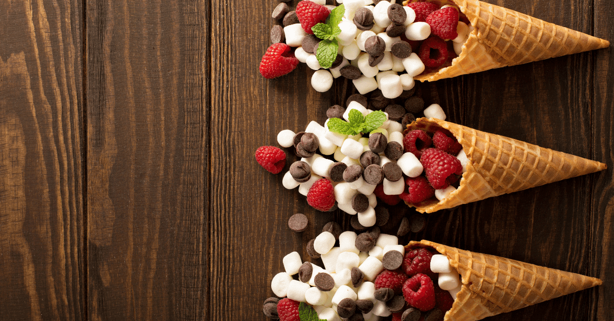 waffle cones filled with mini marshmallows chocolate chips and raspberries