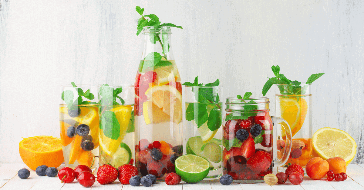 water infused with different kinds of fruit and mint