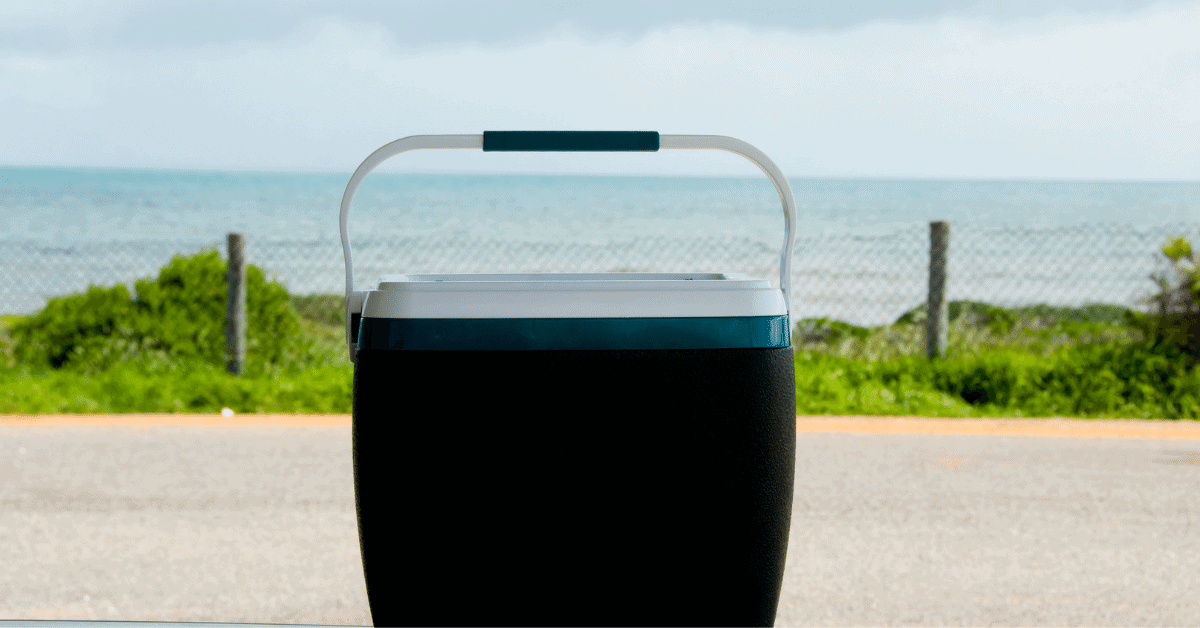 a cooler with a beach in the background