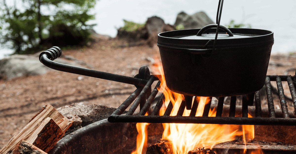 a dutch oven on a campfire