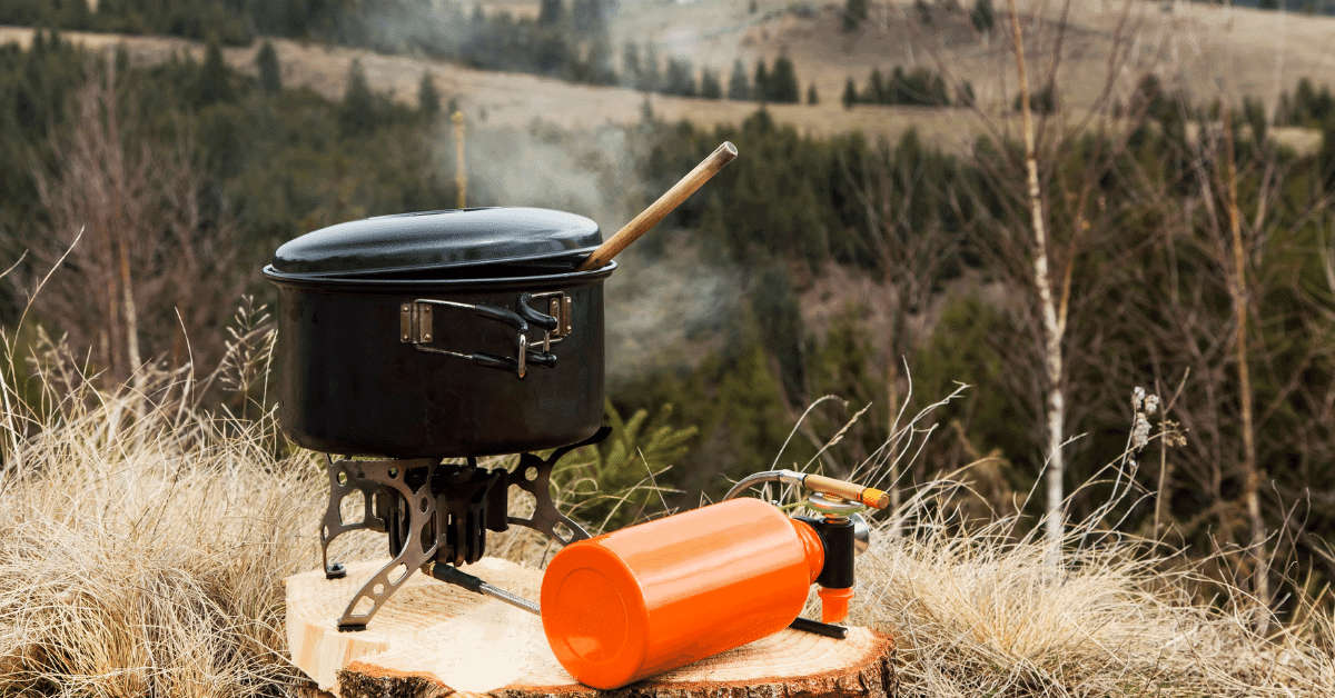 a pot on a camping stove in the wild