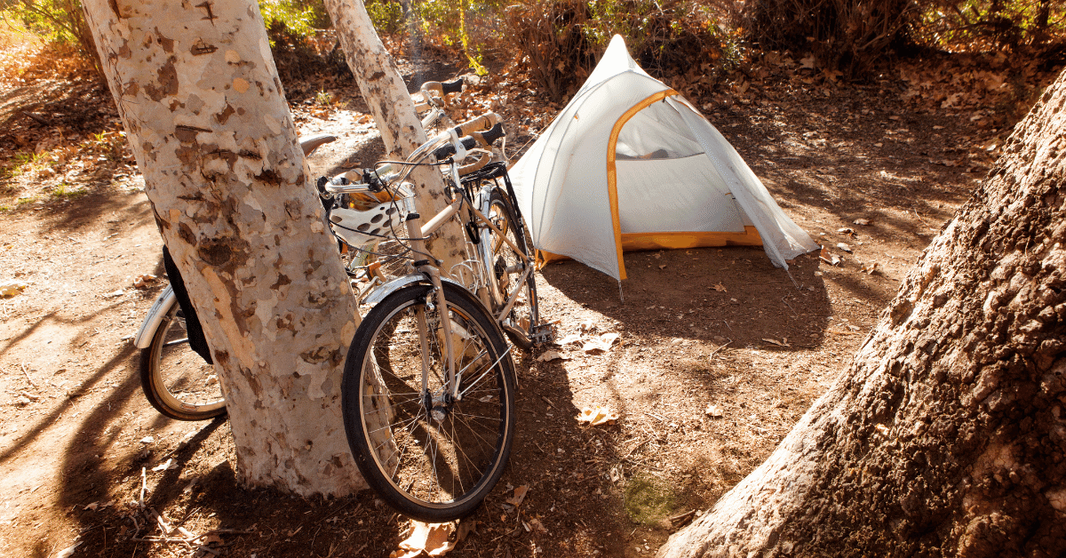 two bicycles next to a tent