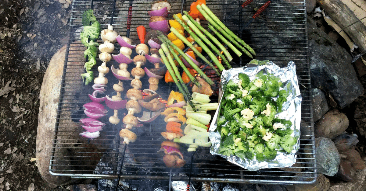 veggies grilling over a campfire