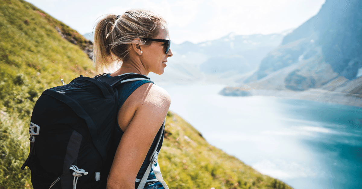 hiker in the mountains by a lake