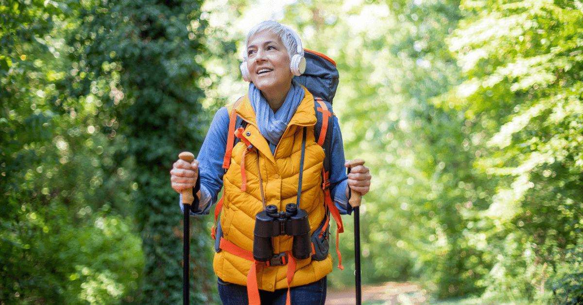woman hiking with headphones on listening to music