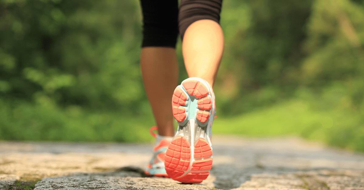 woman walking wearing running shoes