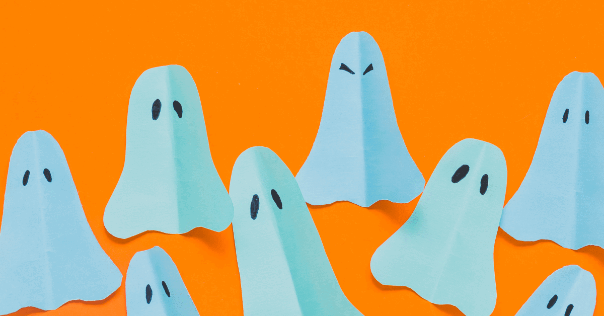 paper ghosts with orange background