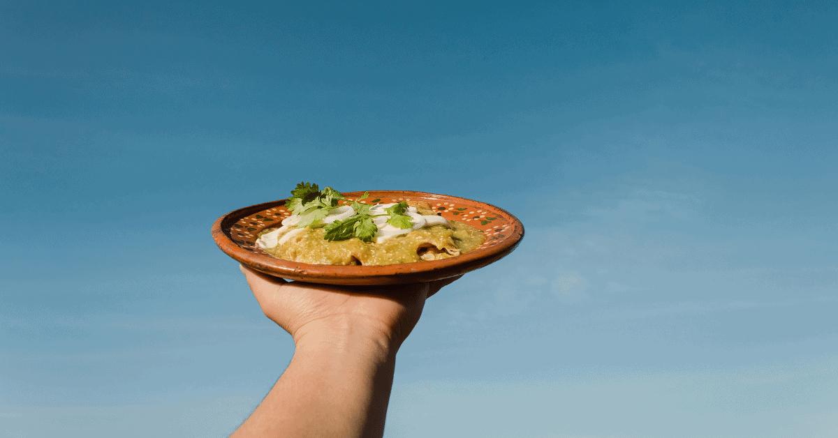 plate of enchiladas with salsa verde