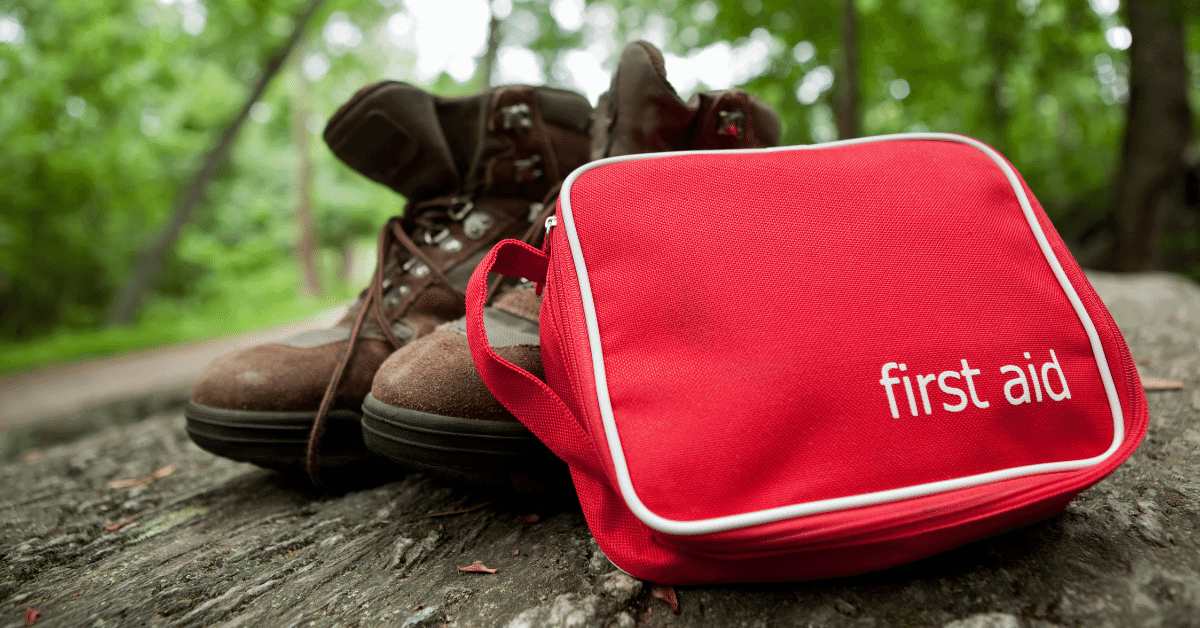 first aid kid and a pair of hiking boots