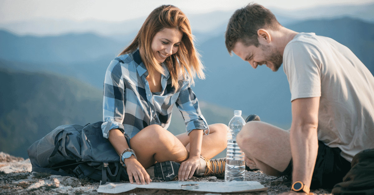 man and woman reading a topographic map