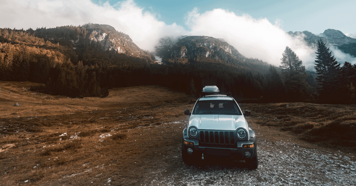 car at a campsite in the mountains