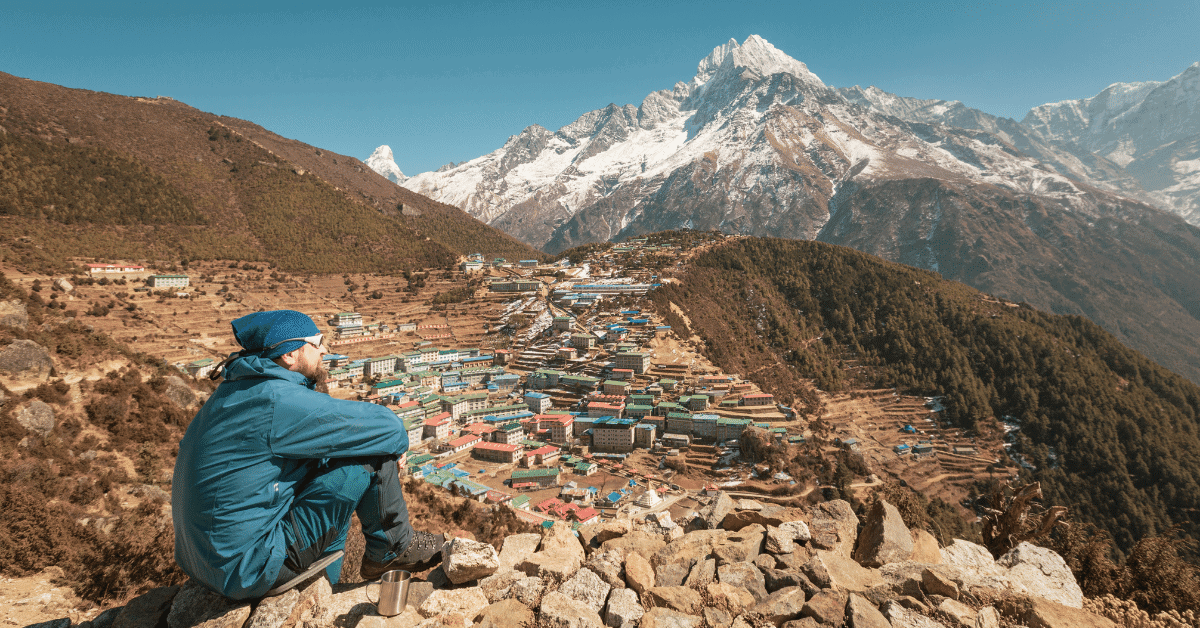 hiker resting in a village at high altitude