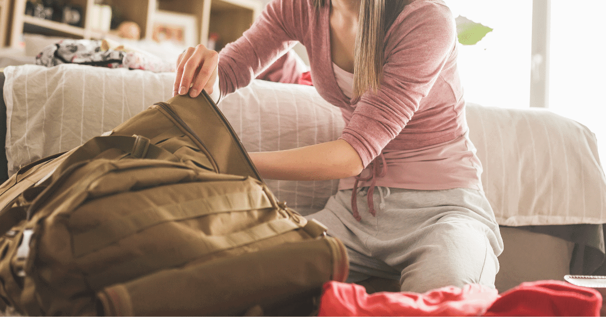 woman packing a backpack