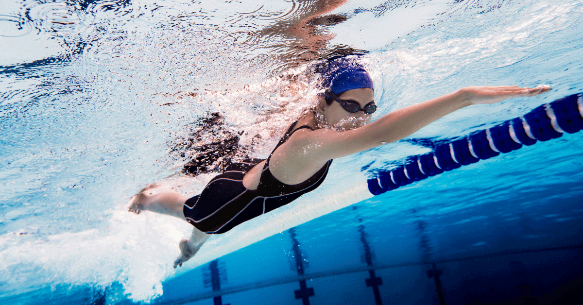 woman swimming laps in a pool